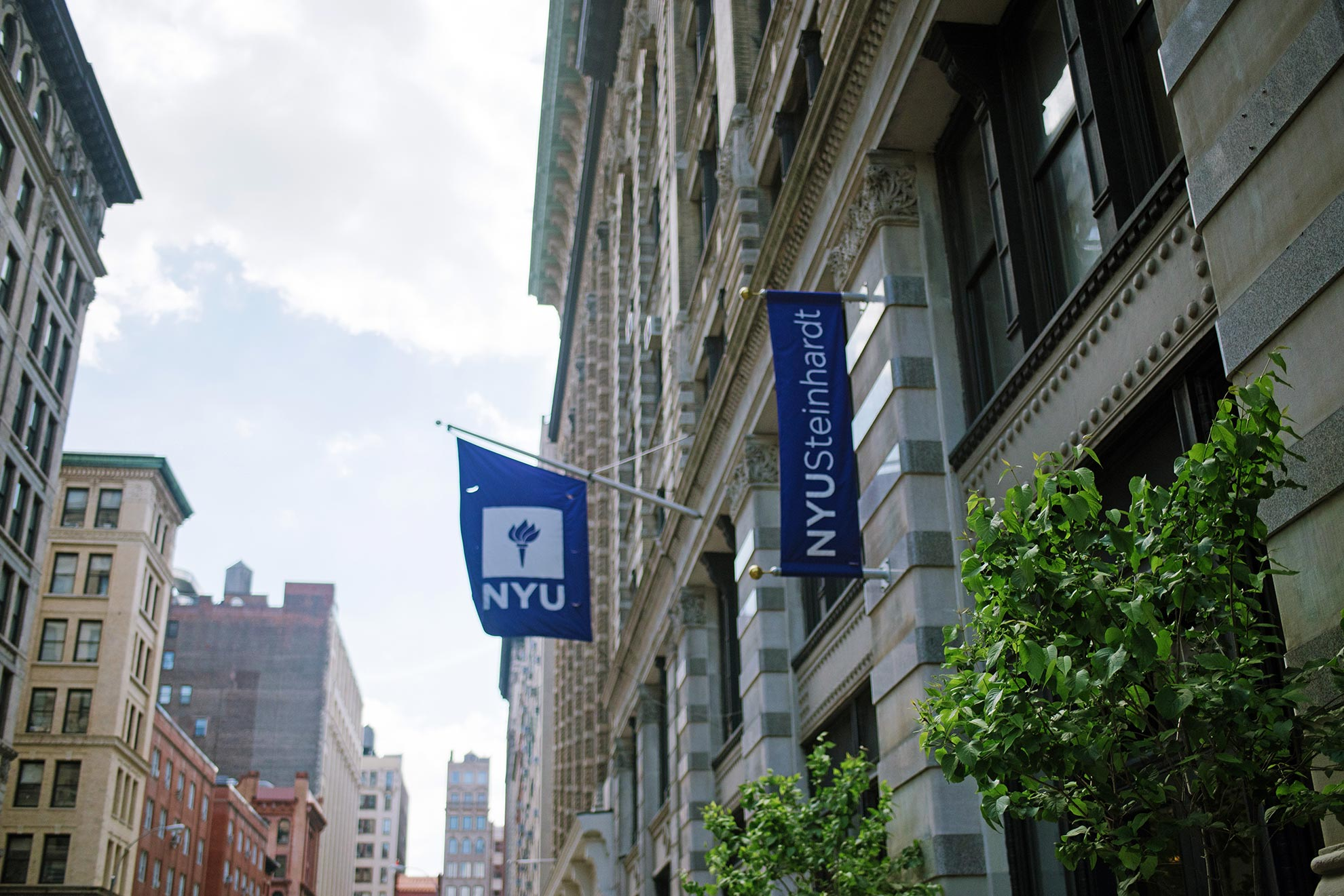 NYU Steinhardt building and flags