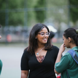 A teacher talking with two students