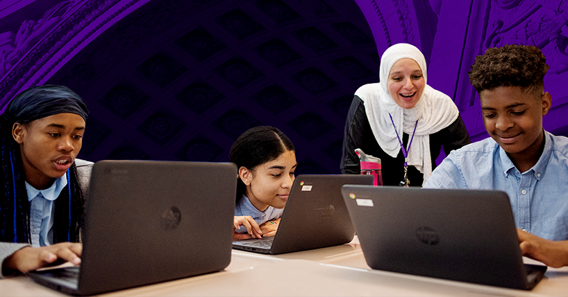 Three students work on laptops as an NYU Teacher Resident supports their learning.